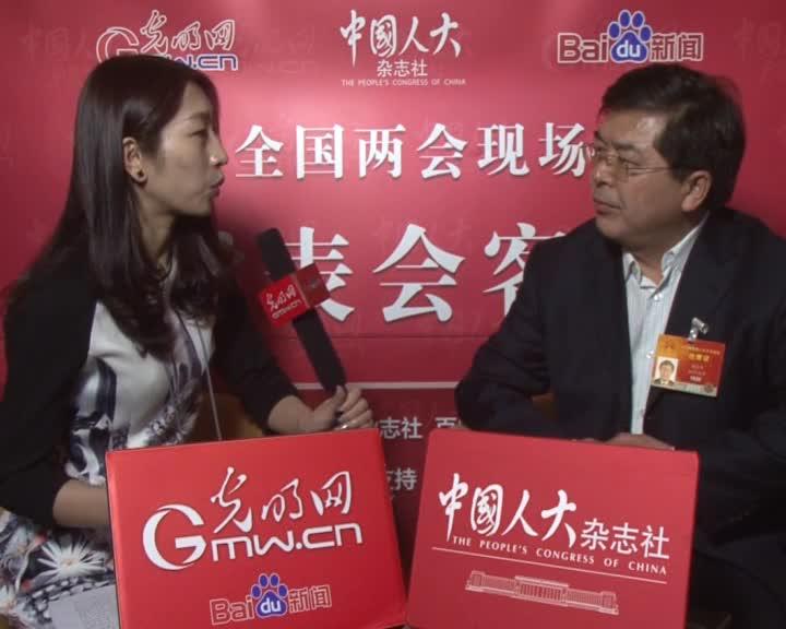 檀结庆代表:搞好教育可增加国际舞台发言分量